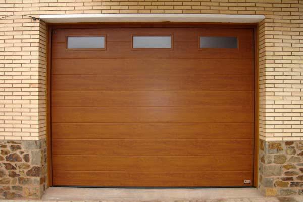 Obras realizadas archivos p gina 4 de 6 prat for Puertas de madera para cochera