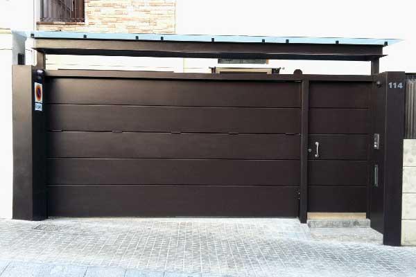 Obras realizadas archivos prat for Puerta garaje metalica