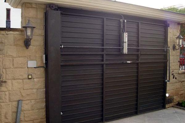 Motorizaci n de puerta basculante prat - Puertas abatibles garaje ...